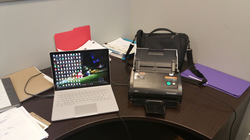 I'm putting my Fujitsu ScanSnap to good use in a client's office.